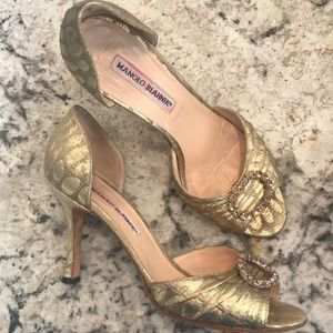 Gently used Manolo Blahnik jeweled heels shoes.